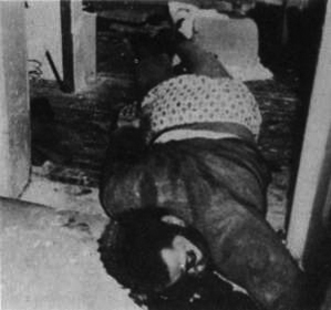 Body of Fred Hampton.  He was  shot twice in the head, while asleep, at point blank range, by members of the Chicago Police Department.
