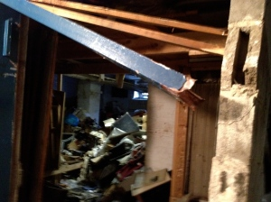 """She came in through the basement window..."" Street level window can be seen at the back, as well as Sandy's path as she flooded the storage space in the basement ripping metal doors from their hinges and damaging cement walls."